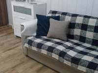 rozkladací pohovka na každodenní spaní v obýváku - chalupa k pronajmutí Velké Karlovice