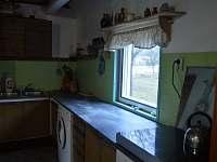 Kuchyňka připojená k hale