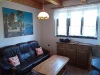 Obývací pokoj - pronájem chaty Malá Bystřice