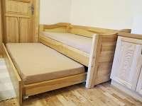Pohovka v ložnici - apartmán k pronajmutí Velké Karlovice