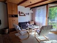 obývací pokoj - chata k pronajmutí Semetín