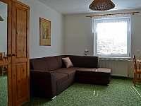 Jednolůžkový pokoj, sedačka
