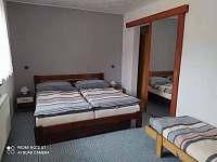 Ložnice - apartmán k pronájmu Tichá