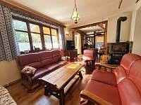 Společenská místnost - chata k pronájmu Kunčice
