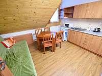 Apartmán C - kuchyňka s pohovkou