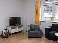 Obývací pokoj - pronájem chaty Nové Losiny