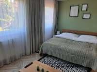 Manželská postel - apartmán k pronajmutí Zlaté Hory