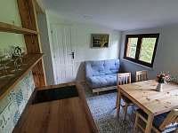 Jídelna s rozkládací pohovkou (přistýlka) - apartmán ubytování Kunčice