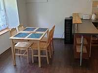 Jídelna spodního apartmánu - pronájem chalupy Holčovice - Spálené
