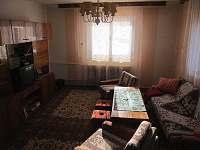Společenská místnost a obývací pokoj