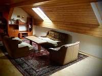 Společenská místnost v podkroví