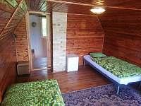 větší pokoj v podkroví - pronájem chaty Zliv