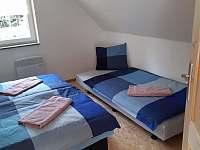 Ložnice s manželskou postelí a jedním lůžek navíc - Vitějovice