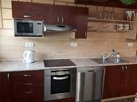 kuchyně v apartmánu /přízemí/