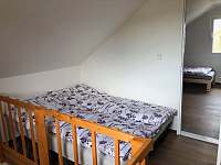 Průchozí ložnice s rozkládací sedačkou - Šakvice