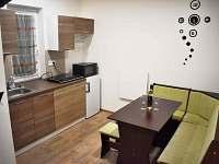 Apartmán Laura - kuchyň s lavicí