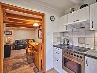 interiér Chata Dolce kuchyň s jídelnou - pronájem Oblanov - Dolce