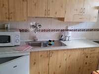 Kuchyň - apartmán - Sklenařice