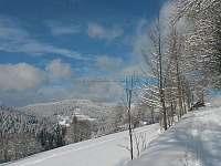 V zimě - pohled od chalupy - ubytování Strážné