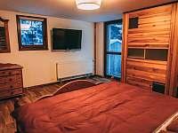 Ložnice v apartmánu - chalupa ubytování Boží Dar