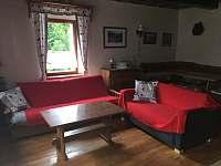 Obývací místnost - chalupa k pronajmutí Jiřetín pod Jedlovou