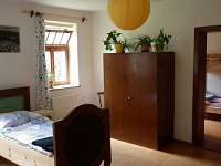 Pokoj č.1  a pohled do pokoje s palandou