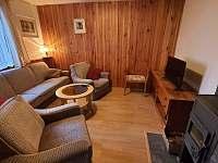 Obývací pokoj přízemí - chata k pronájmu Březová-Oleško