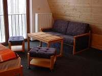 obývací pokoj rozkládací sedačka - pronájem chaty Čenkovice