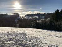 Zimní výhled z terasy našeho apartmánu - k pronajmutí Říčky v Orlických horách