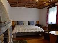 Obývací pokoj - dvoulůžková postel