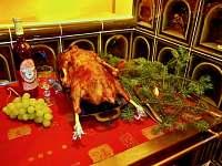 Husa pomalu pečená v peci