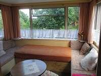 Obývací pokoj s jedním lůžkem