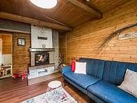 Obývačka s rozkladacou sedačkou - chata k pronájmu Lučivná - Lopušná Dolina