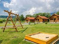 Detské ihrisko - hojdačky a pieskovisko