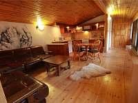 obývací pokoj s kuchyňským koutem - chata k pronajmutí Sýkořice
