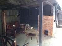 Sauna s venkovním topením.