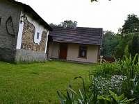 Chata  Podholí s prostorem pro úschovu kol, kočárku......