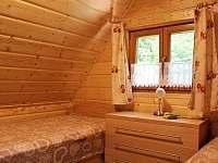 jedna z ložnic - pronájem chaty Lipno - Hůrka