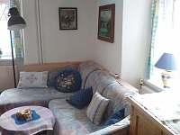Obývací místnost s jídelním koutem