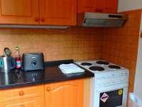 Kuchyň - apartmán k pronájmu Strážný