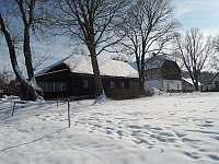 chalupa v zimě - ubytování Javorná