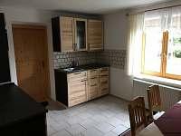 Ubytování na Slučím Tahu - dvoulůžkový apartmánkuchyň s jídelnou