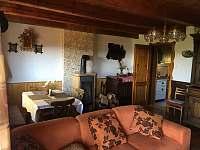 Obývací pokoj - chata k pronájmu Slupečná