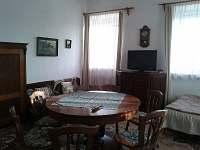 Horní velký apartmán- velká místnost s TV