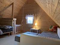 Rozkládací pohovka v podkroví a schodiště - chata k pronajmutí Březí nad Oslavou