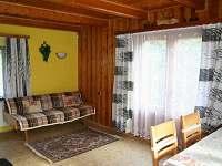 Společenská místnost - chata k pronájmu Popelištná