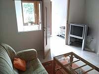 společenská místnost - apartmán k pronajmutí Nové Dvory