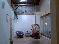 Atrium s houpačkou