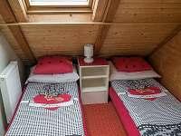 Ap1 podkrovní ložnice