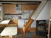 Kuchyň a příkré schody do podkroví